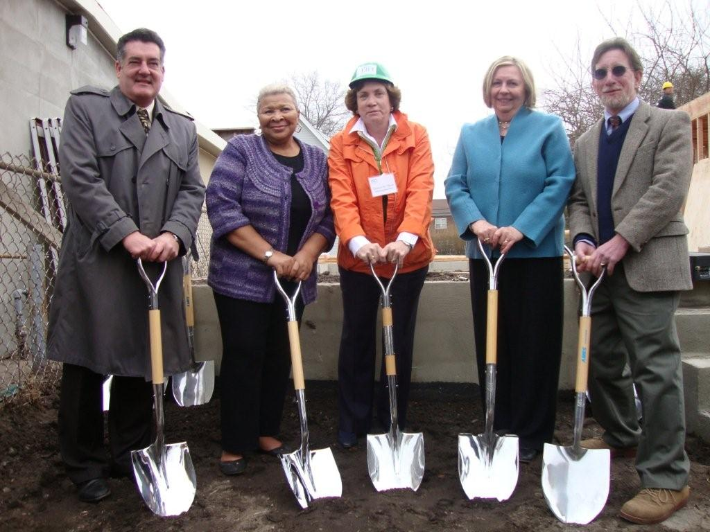 Three Women and Two Men Breaking Ground with Shovels
